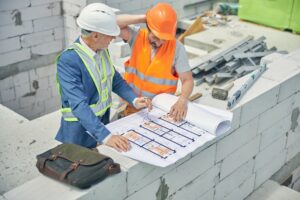 Civil engineer looking at a puzzled male worker